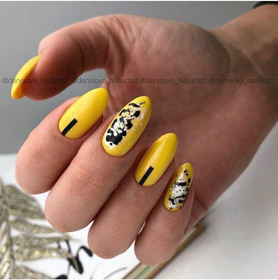 Żółte paznokcie z czarnymi wzorkami