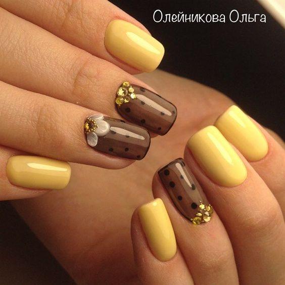 Żółto czarne paznokcie z wzorkami