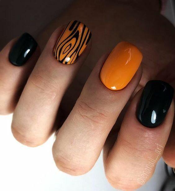 Czarno pomarańczowe paznokcie