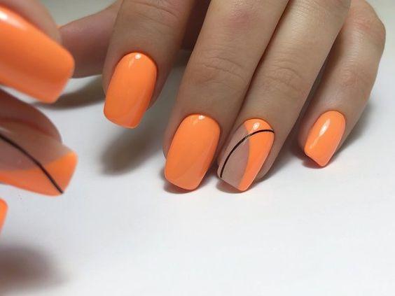 Pomarańczowe paznokcie z geometrycznymi wzorami