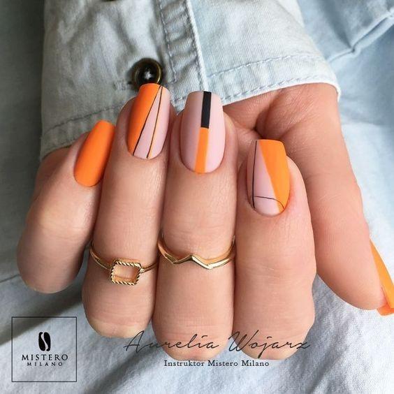 Pomarańczowy manicure z geometrycznymi wzorami